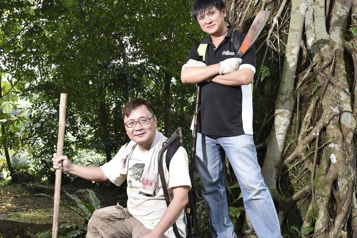 Mr Raymond Goh (far left) and Mr Charles Goh were exposed to the supernatural from a young age.