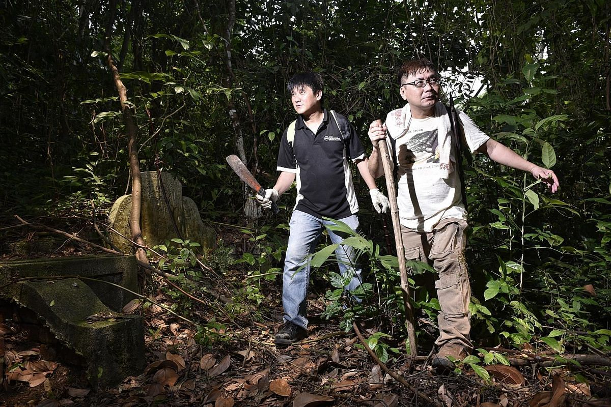 Teamwork: Mr Charles Goh (above left) researches historical maps and pores over old government records, while Mr Raymond Goh is fluent in written Chinese and has an encyclopaedic knowledge of clan lineage.