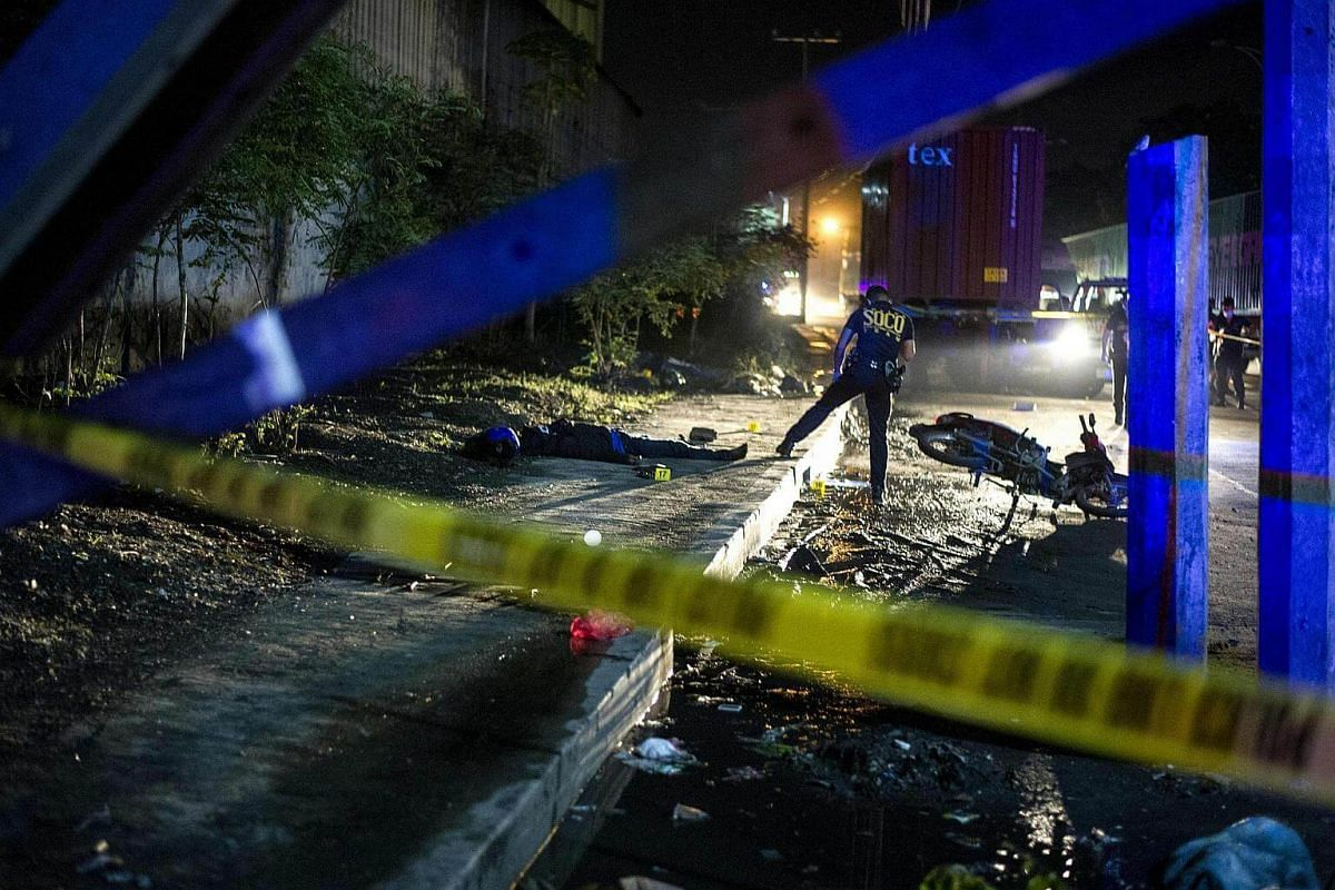 Philippine Scene of the Crime Operatives work at the scene where two suspects were shot dead following an encounter and shootout with police at a checkpoint along a highway in Manila on Aug 28, 2016.