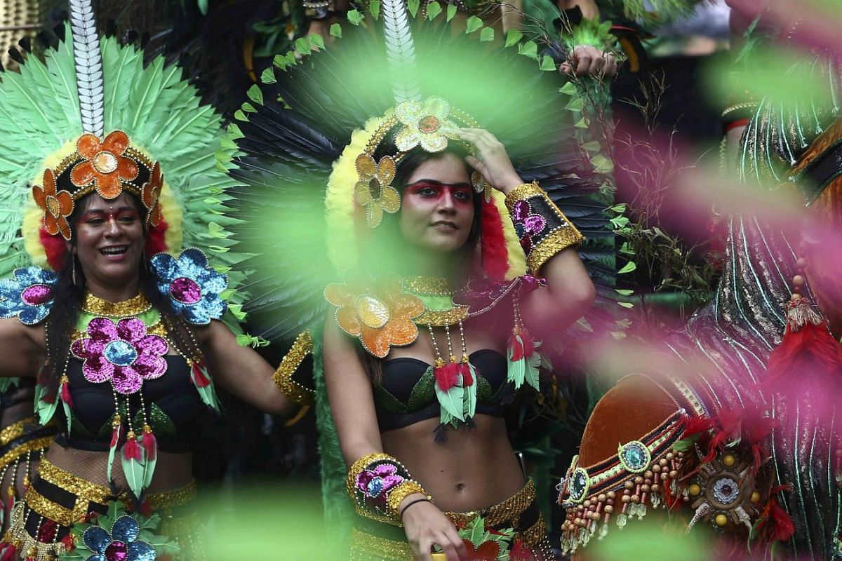 Performers participate in the parade at the Notting Hill Carnival in London, Britain on Aug 29.