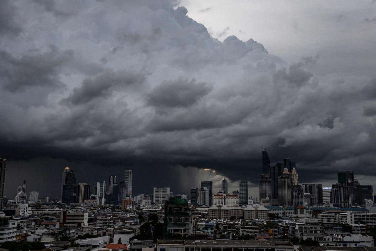 Heavy rain clouds move over the central business district in Bangkok on Aug 29.