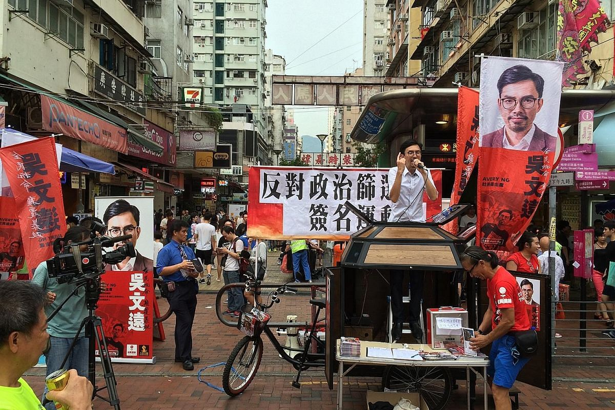 First-time candidate Kenny Wong Chun Kit, a relative unknown from the 19-month-old party Youngspiration, campaigning in the streets of New Territories West. The contenders in a classroom setting on Web TV. Back row, from left: People Power's Mr Chris