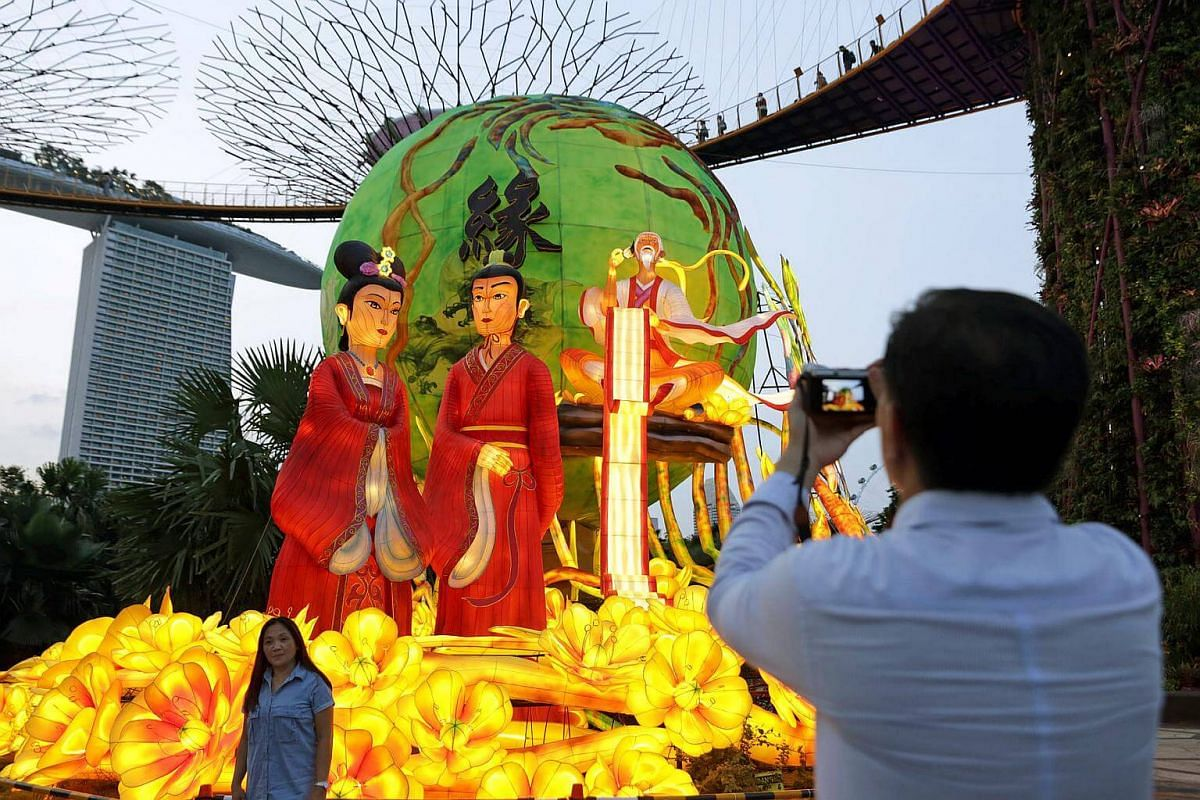 A visitor taking a photo with one of the large lantern sets for the Mid-Autumn Festival, to be displayed at Gardens By The Bay this September.