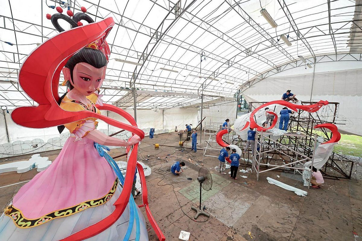 """Craftsmen from China's Sichuan province working on a lantern in the shape of the Chinese moon goddess Chang'e, which will be the centrepiece of the Chinatown Mid-Autumn Festival 2016, themed """"A Sparkling Mid-Autumn Festival""""."""