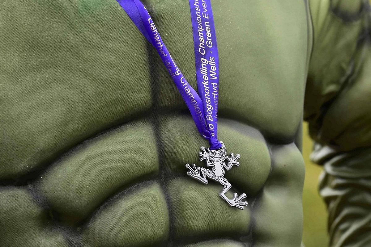 A competitor wears his medal at the 31st World Bog Snorkelling Championships, held annually at Llanwrtyd Wells in Wales, Britain, on Aug 28.