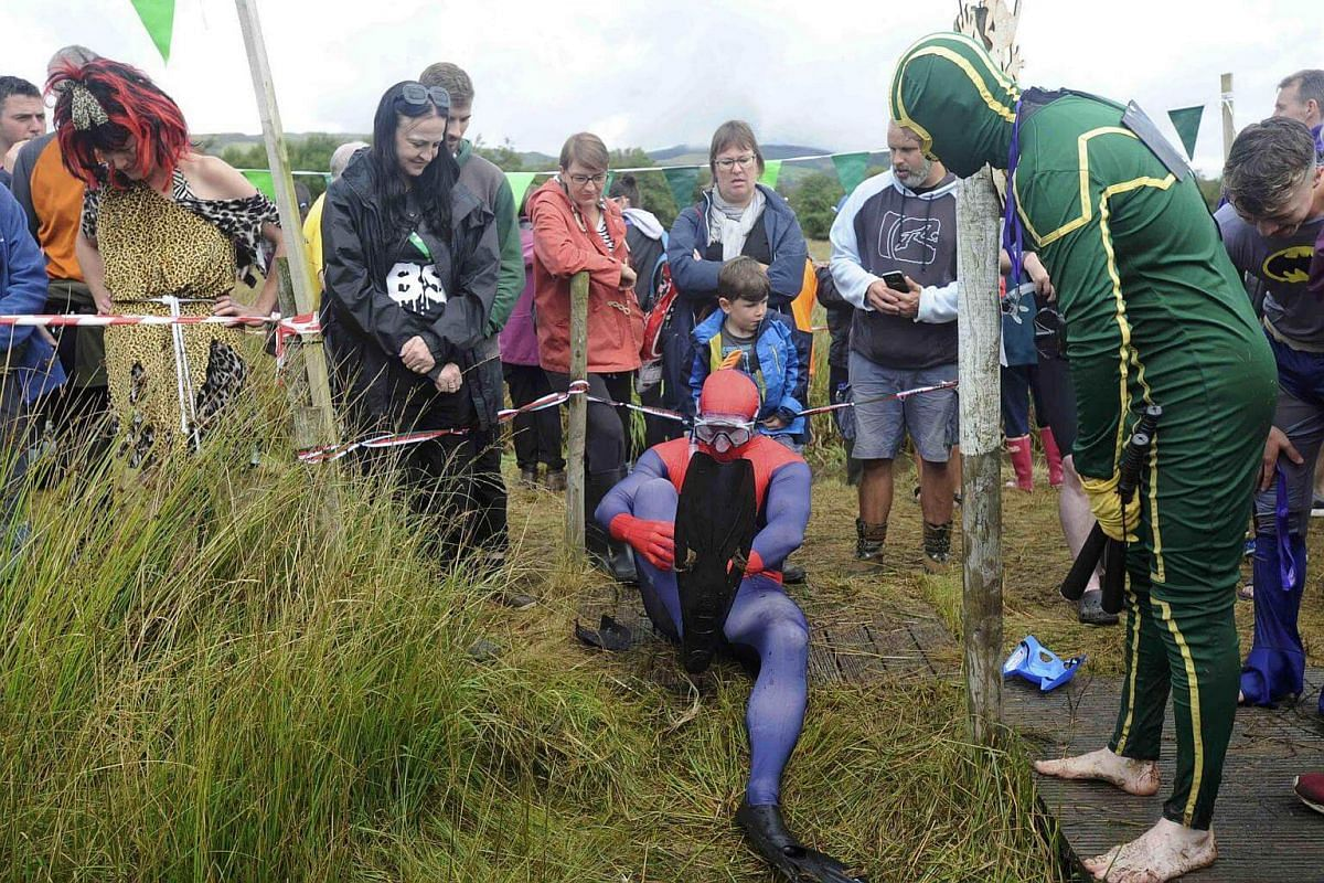 A competitor prepares to take part in the 31st World Bog Snorkelling Championships in Llanwrtyd Wells, Wales, on Aug 28.