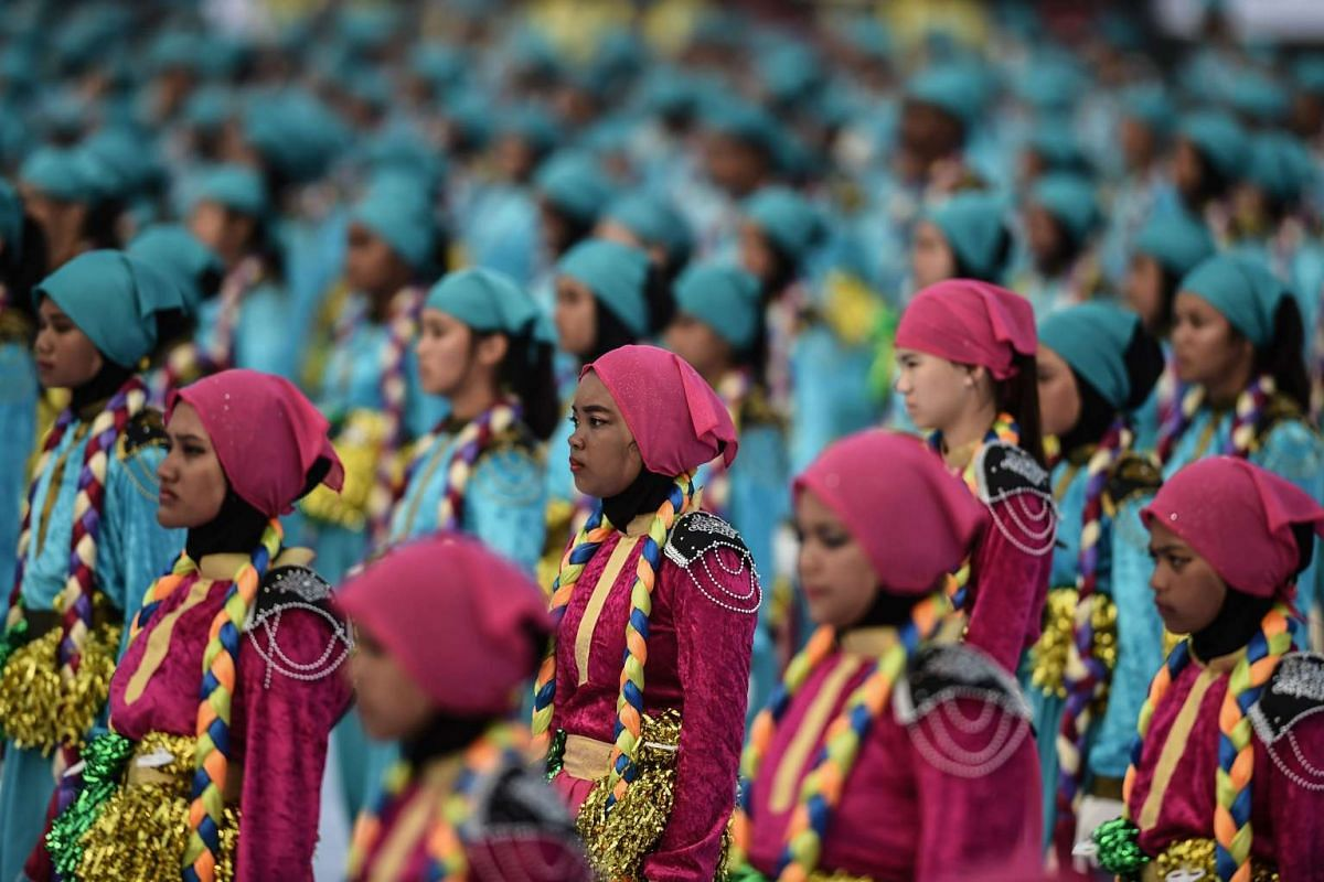 Malaysian schoolchildren perform during the Independence Day celebrations at Independence Square in Kuala Lumpur on Aug 31, 2016.