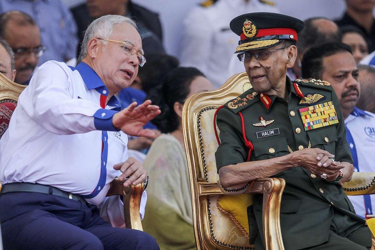 Malaysia's King Abdul Halim Mu'adzam Shah (right) listens to Prime Minister Najib Abdul Razak during the Independence Day celebrations in Kuala Lumpur, Malaysia on Aug 31, 2016.