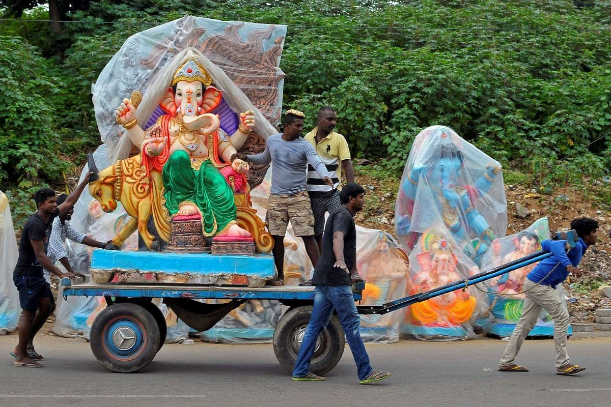 Workers transport a statue of Hindu god Ganesh, the deity of prosperity, on a cart ahead of the Ganesh Chaturthi festival in Bengaluru, India on Aug 30, 2016.