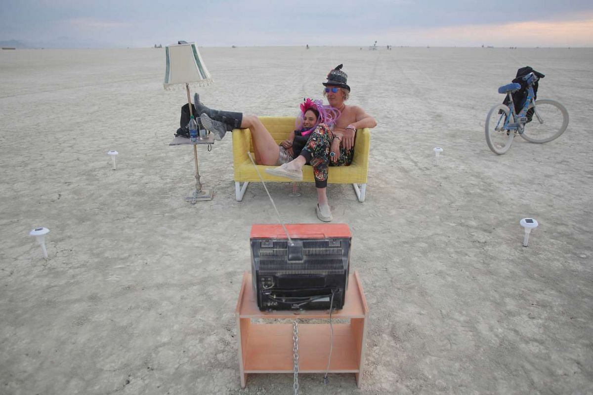 Jody Friedman and Jeff Montgomery in front of the Playa TV as approximately 70,000 people from all over the world gather for the 30th annual Burning Man arts and music festival in the Black Rock Desert of Nevada, US, on Aug 30, 2016.