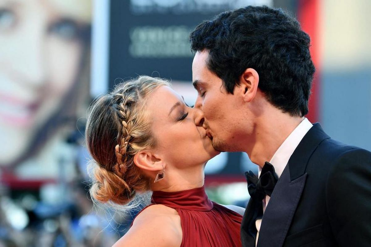 US director Damien Chazelle (right) kisses his girlfriend as they arrive for the opening ceremony and screening of La La Land at the 73rd annual Venice International Film Festival, in Venice, Italy, Aug 31, at Venice Lido..