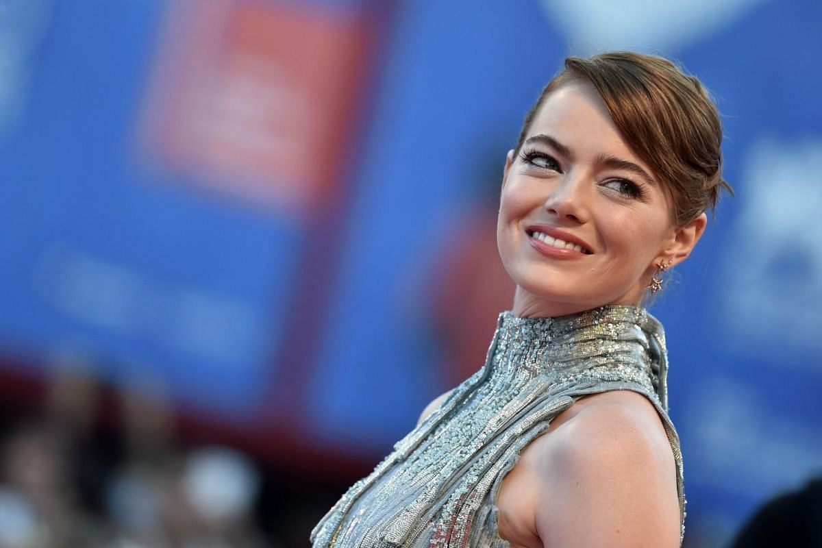 US actress Emma Stone poses on the red carpet as she arrives for the screening of the movie La La Land at the opening ceremony of the 73rd Venice Film Festival, on Aug 31, at Venice Lido.