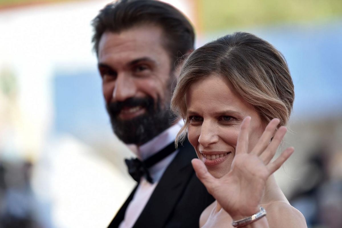 Italian actress Sonia Bergamasco arrives with Italian actor Fabrizio Gifuni before the screening of the movie La La Land for the opening ceremony of the 73rd Venice Film Festival, on Aug 31, at Venice Lido.