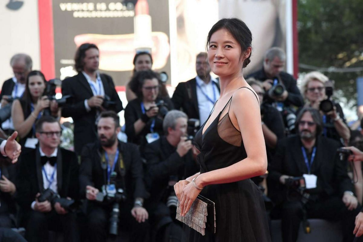 South Korean actress Moon So ri poses on the red carpet before the screening of the movie La La Land for the opening ceremony of the 73rd Venice Film Festival, on Aug 31,  at Venice Lido.