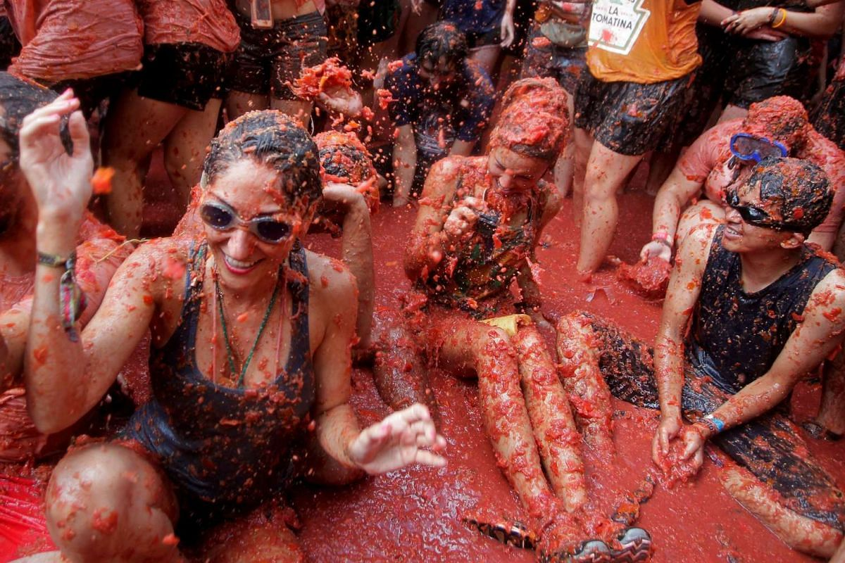 Revellers battle with tomato pulp during the annual Tomatina (tomato fight) festival in Bunol near Valencia, Spain on Aug 31, 2016.
