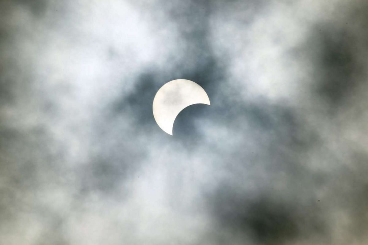 A partial solar eclipse as seen over Abidjan, Ivory Coast, on Sept 1, 2016.