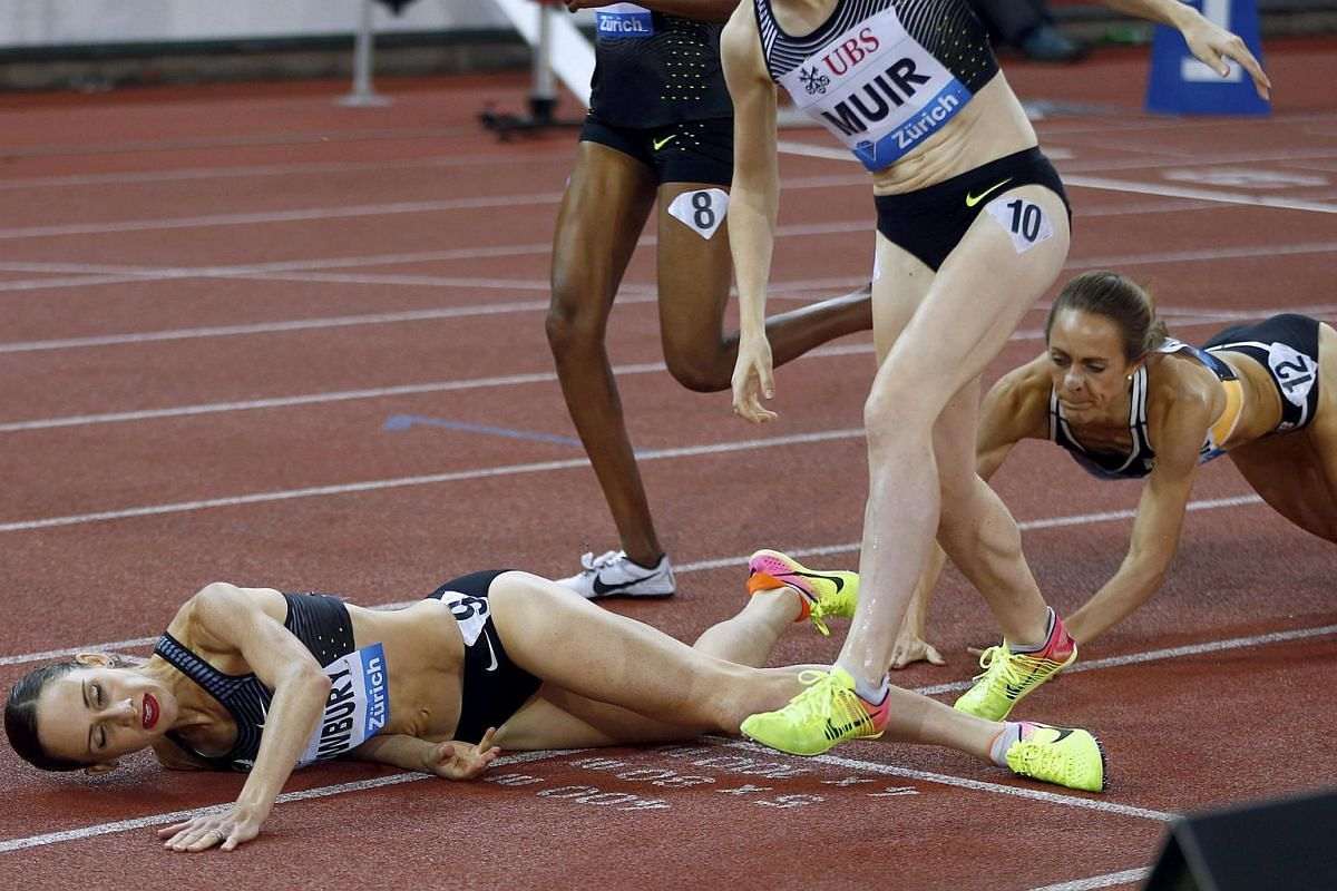 Shannon Rowbury of USA falls after winning the 1500m women next to Laura Muir of Britain during the IAAF Athletics Diamond League at Letzigrund stadium, Zurich, Switzerland on Sept 1, 2016.