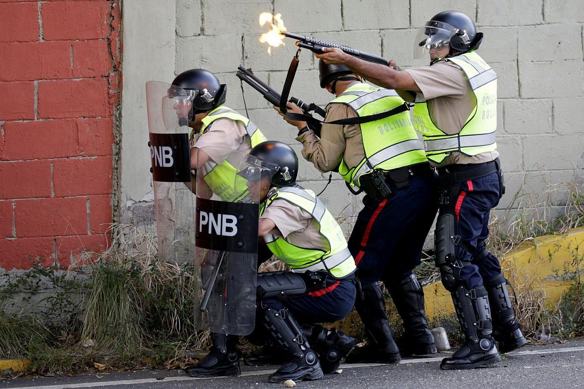 Riot police clash with protesters during a rally to demand a referendum to remove Venezuela's President Nicolas Maduro in Caracas, Venezuela, on Sept 1, 2016.