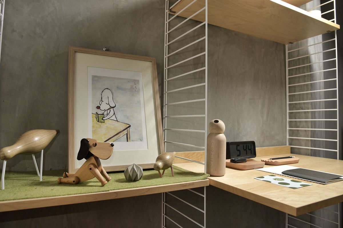 Products at Bibliotek Design Store include a Normann Copenhagen shorebird figure ($80 for large, $48 for small, left), and a Desinere Rok concrete paperweight ($34, third from left).