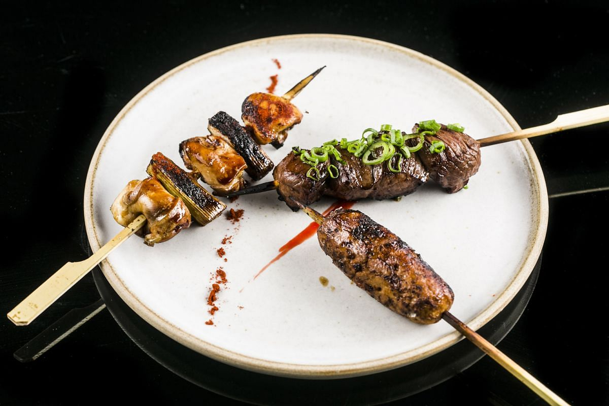 """Among the smoked options are the skewers (above, clockwise from left) – Chicken Thigh, Wagyu Striploin and Chicken Tsukune – and the Emperor Snapper """"En Papillote""""."""