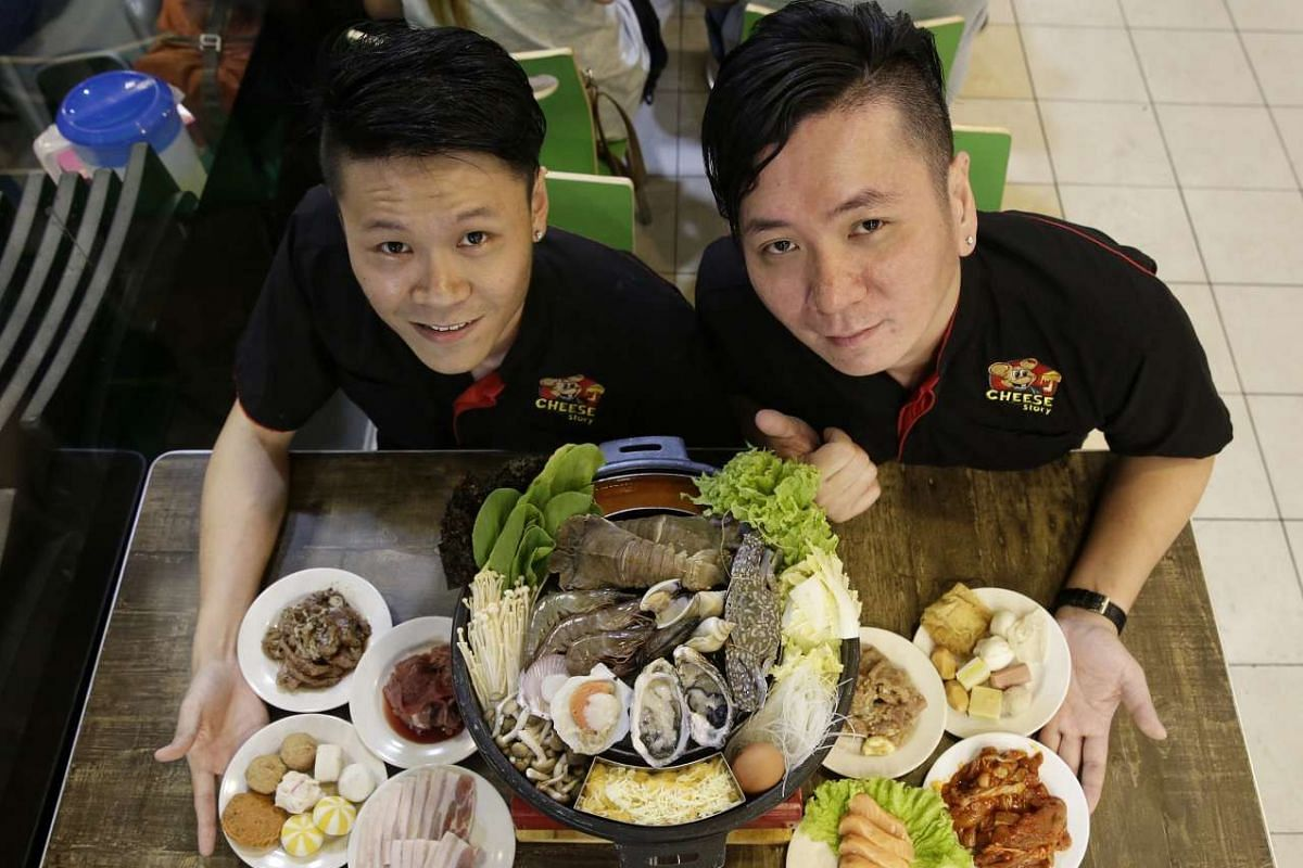 Cheese Story owners Ebenezer Ong (left) and Elvis Ooi with their cheese mookata at Golden Mile Complex.