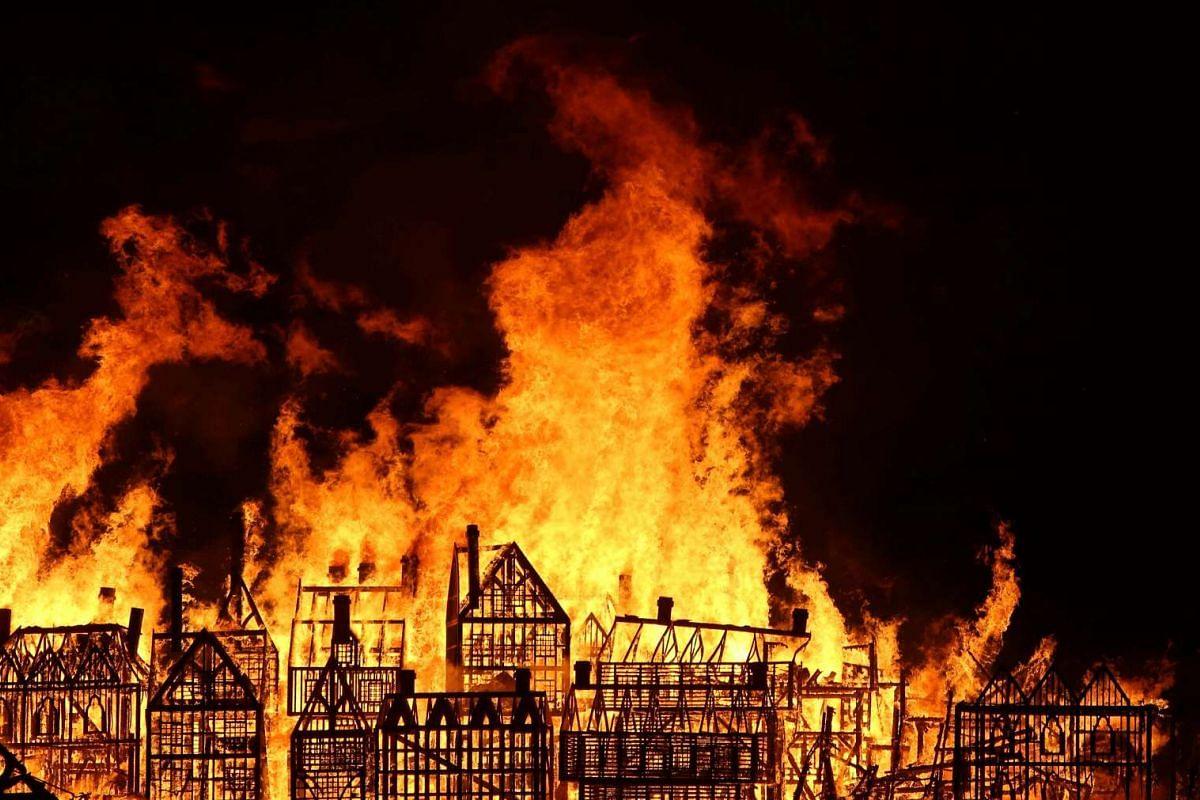 A 120m-long model of the 17th century London skyline is set alight on the River Thames to commemorate the 1666 Great Fire of London on Sept 4, 2016.