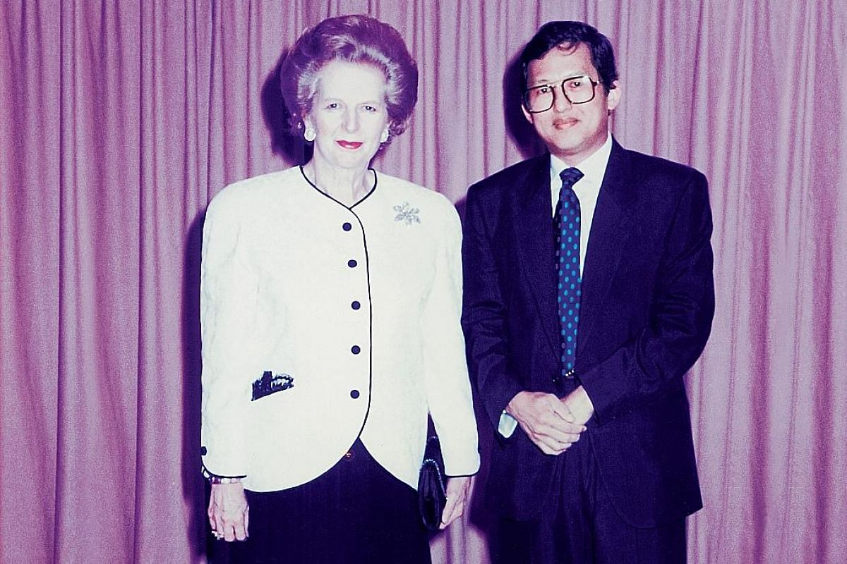My life so far: Mr Kwek with French designer Philippe Starck, who designed the M Social hotel; and with former British prime minister Margaret Thatcher (both above) in the 1990s.
