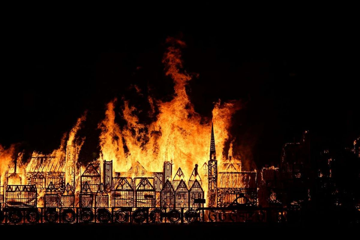 A 120-meter long model of the 17th century London skyline is set alight on the River Thames to commemorate the 1666 Great Fire of London in London, Britain on Sept 4, 2016.