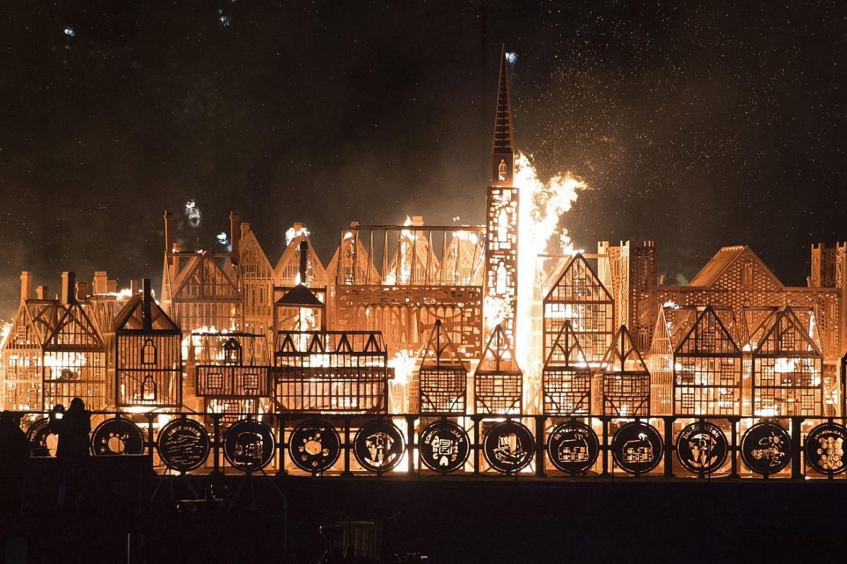 A sculpture of 17th Century London set on barges in the Thames River is set alight to mark the 350th anniversary of the Great Fire of London, in central London, Britain on Sept 4, 2016.