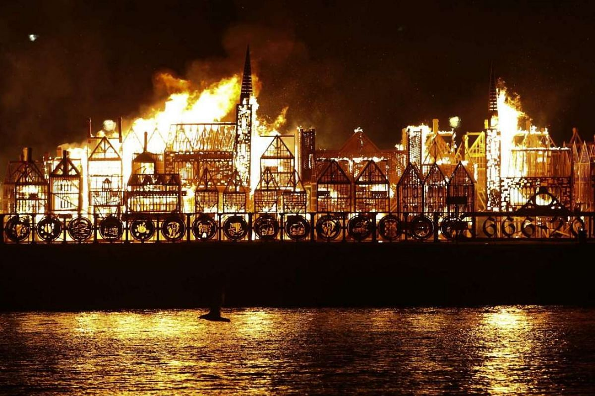 A replica of 17th-century London on a barge floating on the river Thames burns in an event to mark the 350th anniversary of the Great Fire of London, in London on Sept 4, 2016.