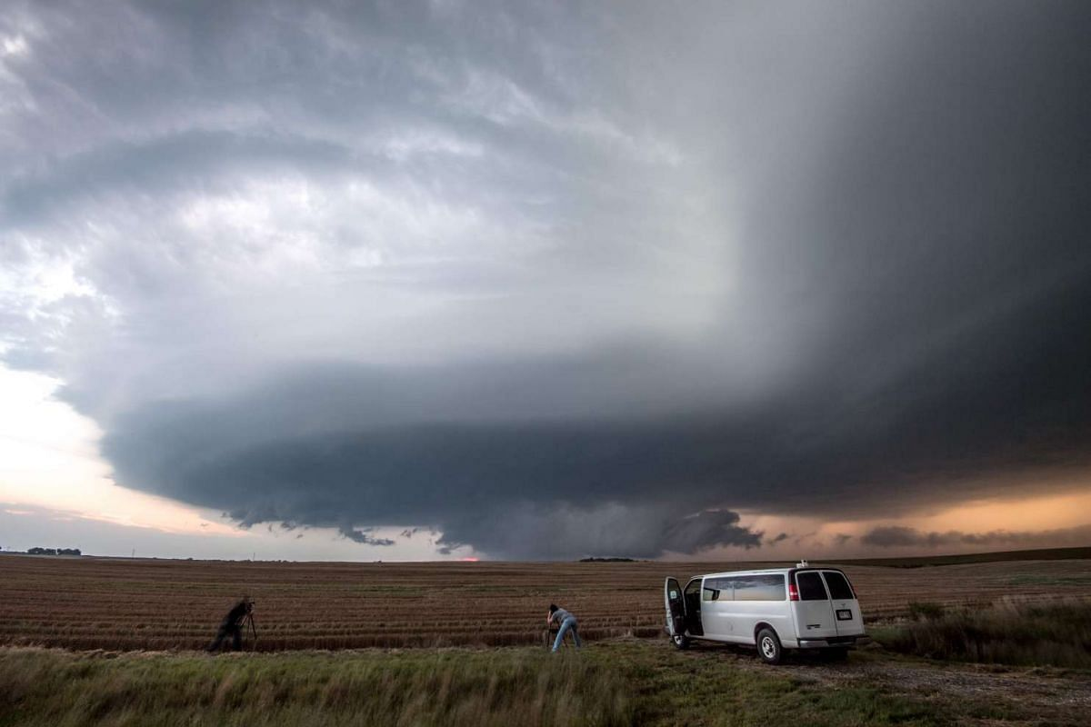 A photo released today, September 5, 2016, shows storm chasing photographers taking photos underneath a rotating supercell storm system in Maxwell, Nebraska on September 3, 2016. PHOTO:  AFP