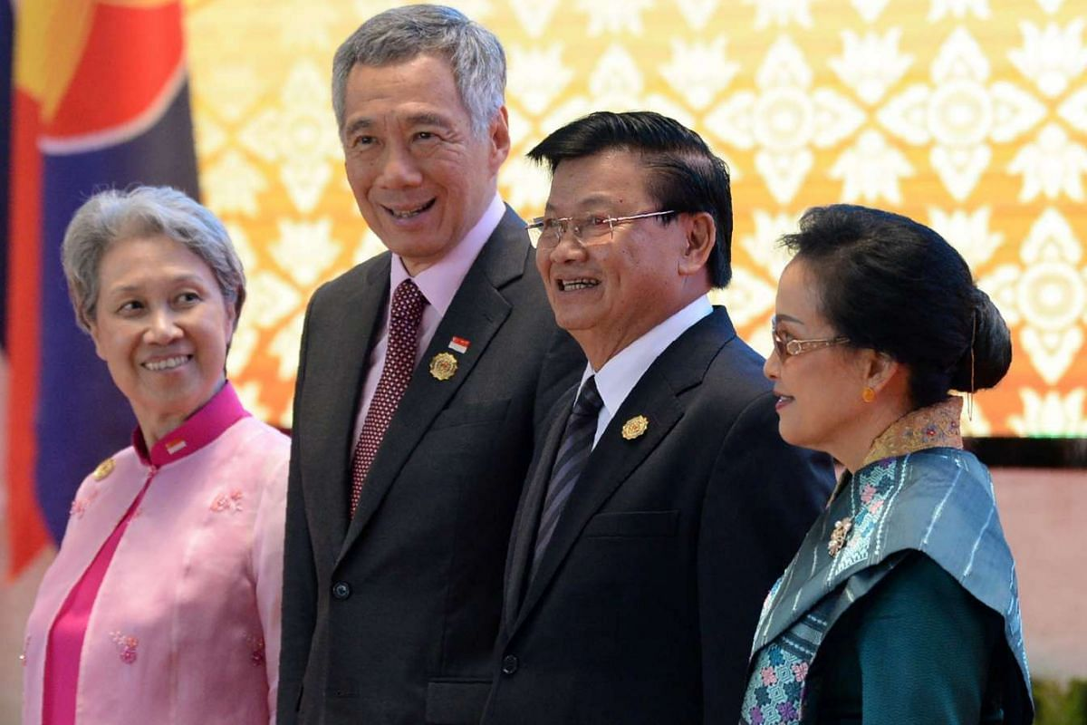 Laos Prime Minister Thongloun Sisoulith and his wife Naly with Mr and Mrs Lee Hsien Loong at the opening ceremony of the Asean Summit in Vientiane on Sept 6, 2016.