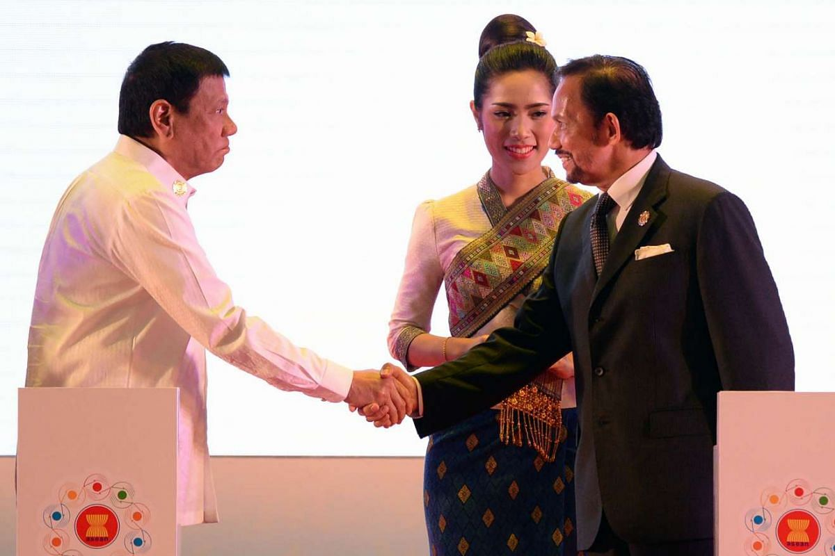 Philippine President Rodrigo Duterte (left) shakes hands with Brunei's Sultan Hassanal Bolkiah at the opening.