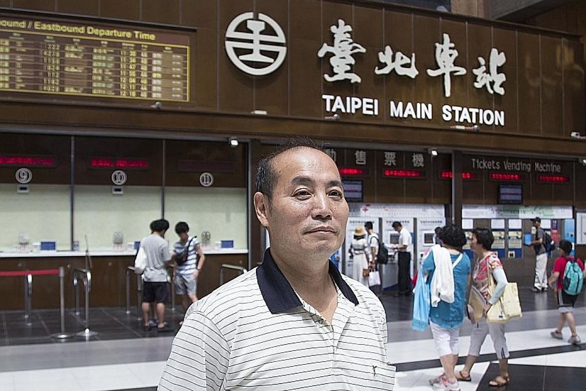 The station has become a popular hangout for young Taiwanese and foreign workers. On weekends, many of them sit on the black-and-white-tiled lobby floor and turn it into a picnic area. Above: Taipei Main Station, which has been newly renovated to cel