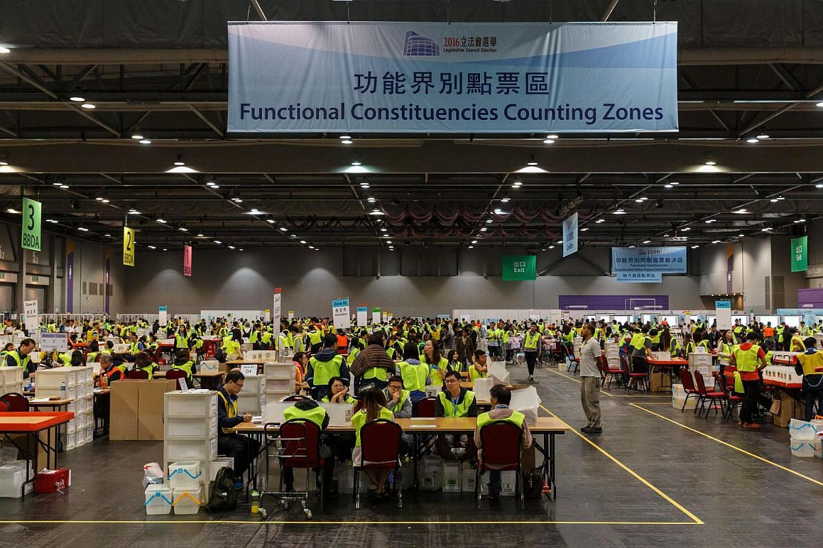 Electoral officials count votes that were cast for the Legislative Council election at the central counting station in Hong Kong on Sept 4, 2016.
