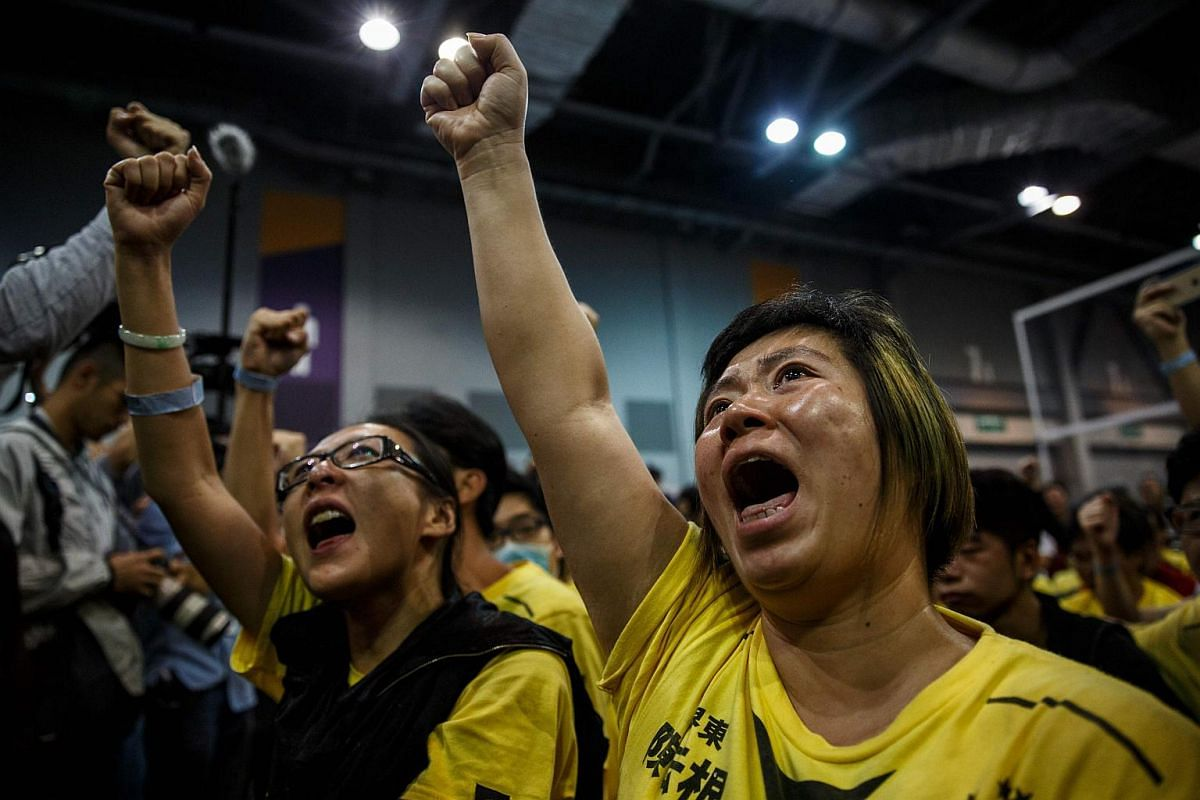 A supporter cries as she celebrates the win of Civic Passion's Cheng Chung-tai in the Legislative Council election, at the central counting station in Hong Kong on Sept 5, 2016.