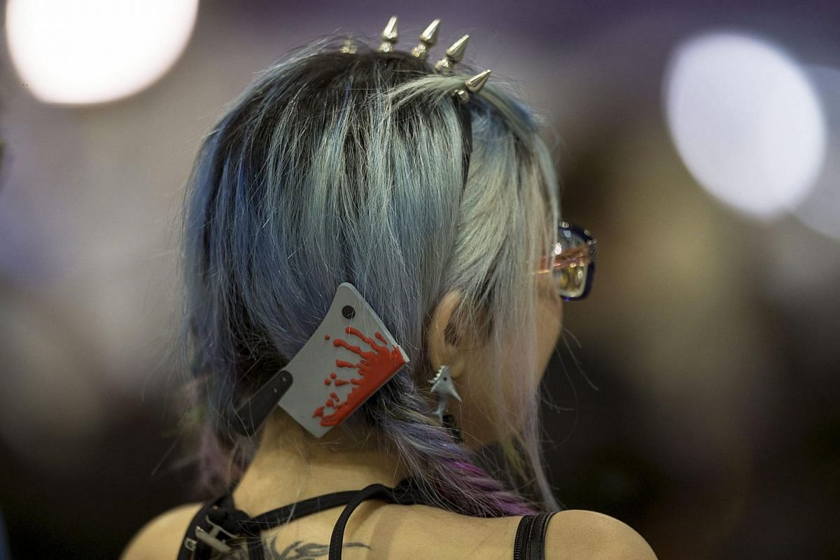 A supporter of a Civic Passion candidate, who advocates self-determination for Hong Kong, wears a hair clip in the shape of a bloody meat cleaver in the Central Counting Station at AsiaWorld Expo in Hong Kong, China on Sept 4, 2016.