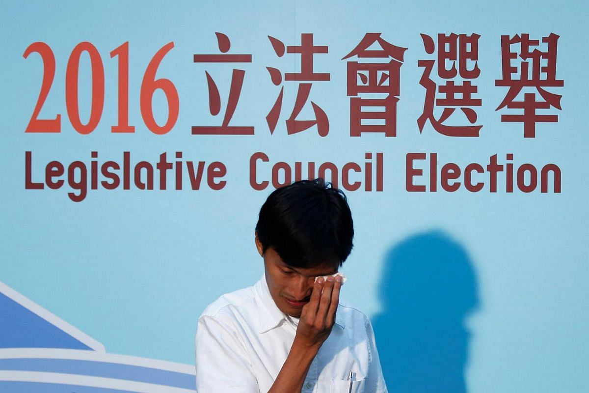Eddie Chu Hoi-dick weeps after winning a seat in the Legislative Council election, in Hong Kong, China on Sept 4, 2016.