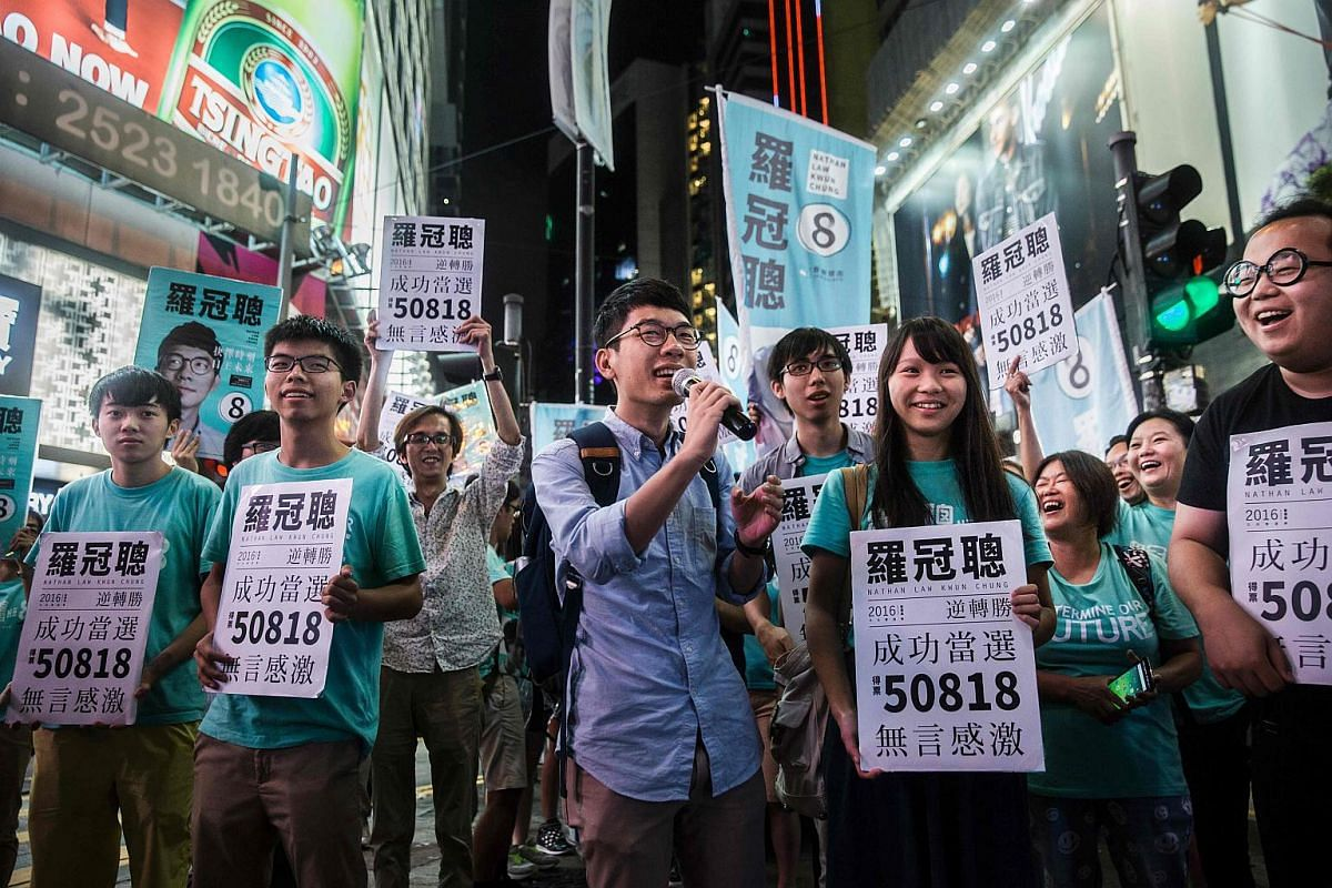 Nathan Law (centre) speaks at a rally with Jousha Wong (third from left) and supporters in Causeway bay following Nathan Law's win in the Legislative Council election in Hong Kong on Sept 4, 2016.
