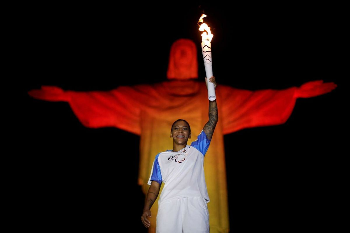 Brazil's judo athlete Rafaela Silva holds the Paralympic  torch during a ceremony at the Christ the Redeemer statue ahead of the 2016 Rio Paralympic games in Rio de Janeiro, Brazil on September 6, 2016. PHOTO: REUTERS