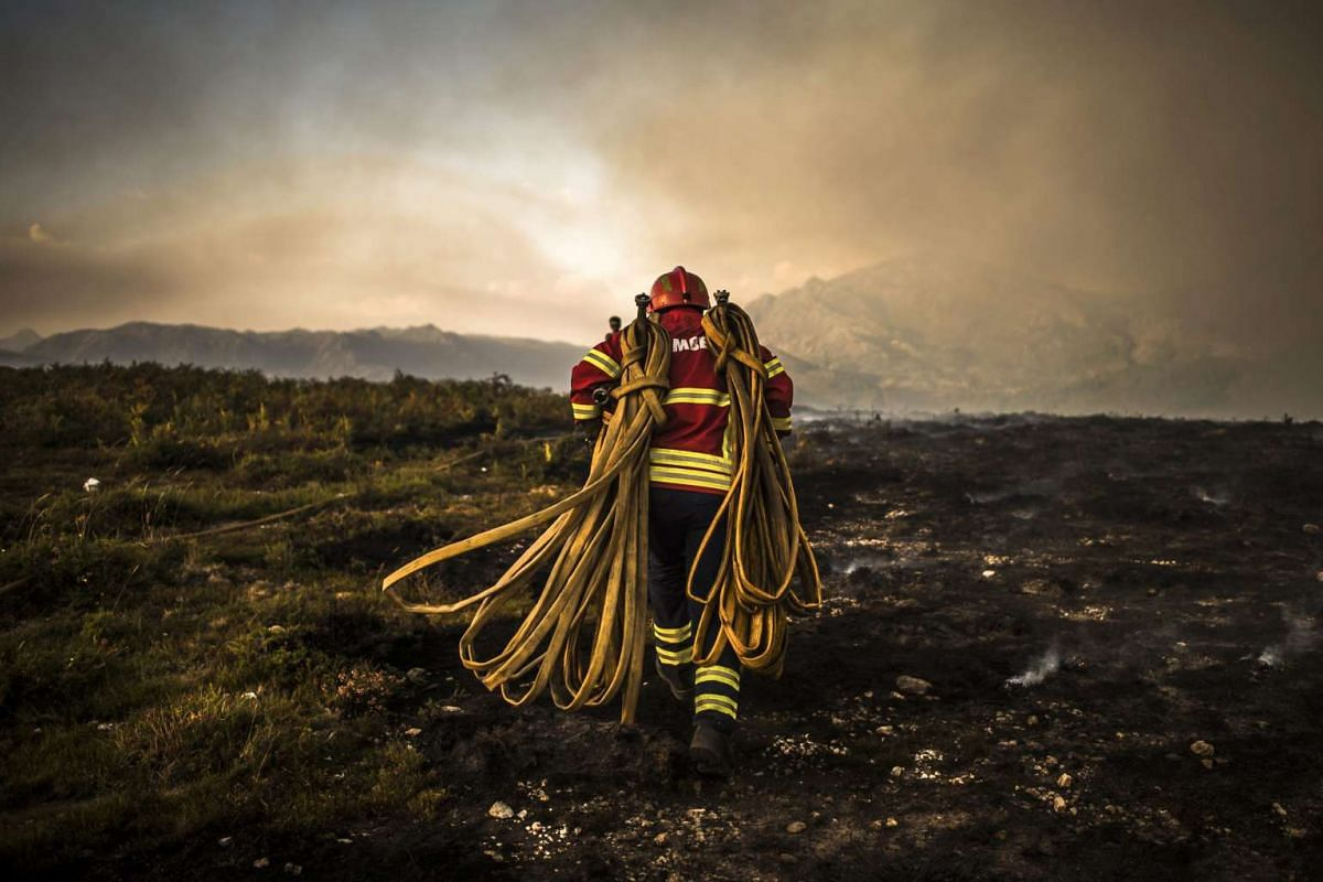 Firemen tackle the forest fire in the area of Vila do Soajo, northern Portugal, September 6, 2016. PHOTO: EPA