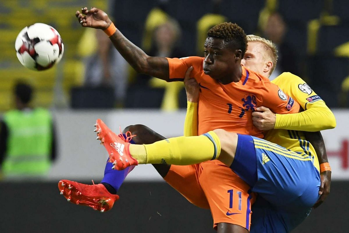 Netherlands Quincy Promes and Sweden's Oscar Wendt during the FIFA World Cup 2018 qualifying soccer match Sweden vs Netherlands at the Friends Arena in Stockholm, Sweden, September 6, 2016. PHOTO: EPA