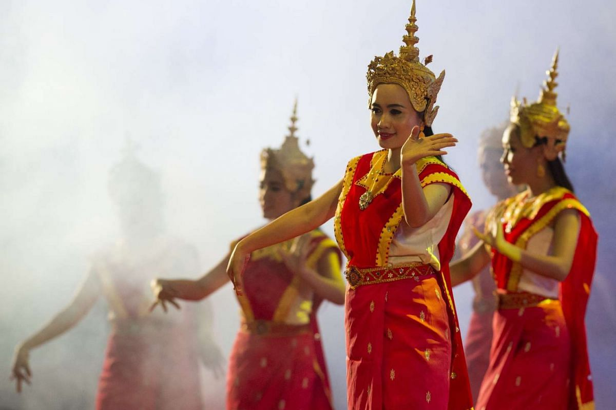 Dancers perform in front of a smoke machine during the gala dinner at the 28th and 29th Asean Summits at the National Convention Centre in Vientiane, Laos, on Sept 7, 2016.