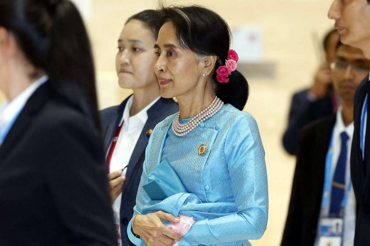 Myanmar State Counsellor Aung San Suu Kyi arrives at the gala dinner of the 28th and 29th Asean Summits at the National Convention Centre in Vientiane, Laos, on Sept 7, 2016.