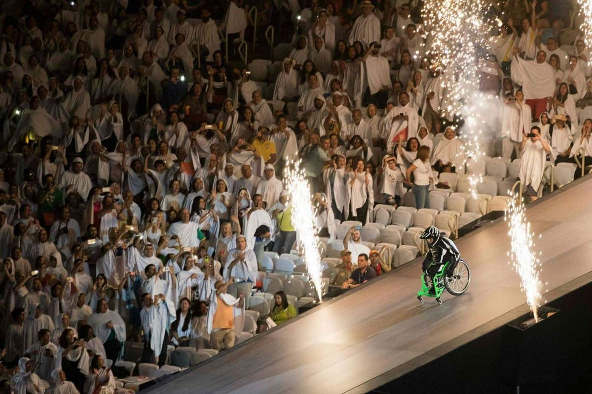 Aaron Wheelz, an extreme wheelchair athlete, goes down a MegaRamp and tears through the panel with the number zero, marking the start of the Rio 2016 Paralympic Games at the Maracana Stadium in Rio de Janeiro, Brazil, on Sept 7, 2016.