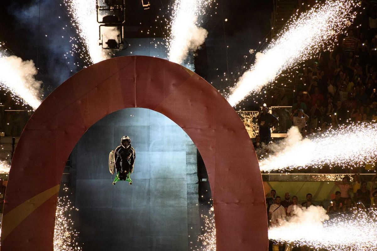 Aaron Wheelz, extreme wheelchair athlete, makes a spectacular entrance at the start of the opening ceremony of the Paralympic Games at Maracana Stadium in Rio de Janeiro, Brazil, on Sept 7.