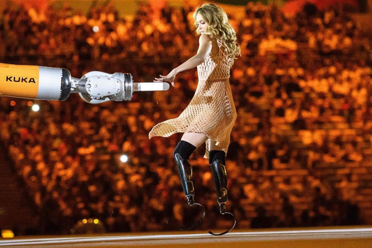 American Paralympic snowboarder Amy Purdy dances with a robot during the opening ceremony of the Rio 2016 Paralympic Games at the Maracana Stadium in Rio de Janeiro, Brazil, on Sept 7, 2016.