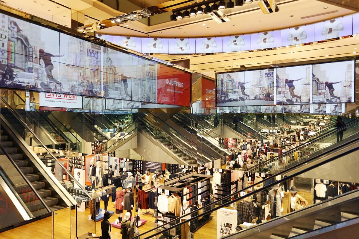A total of 286 digital display screens (above), the most used in any Uniqlo store in the world, can be found at the Singapore flagship store in Orchard Central.