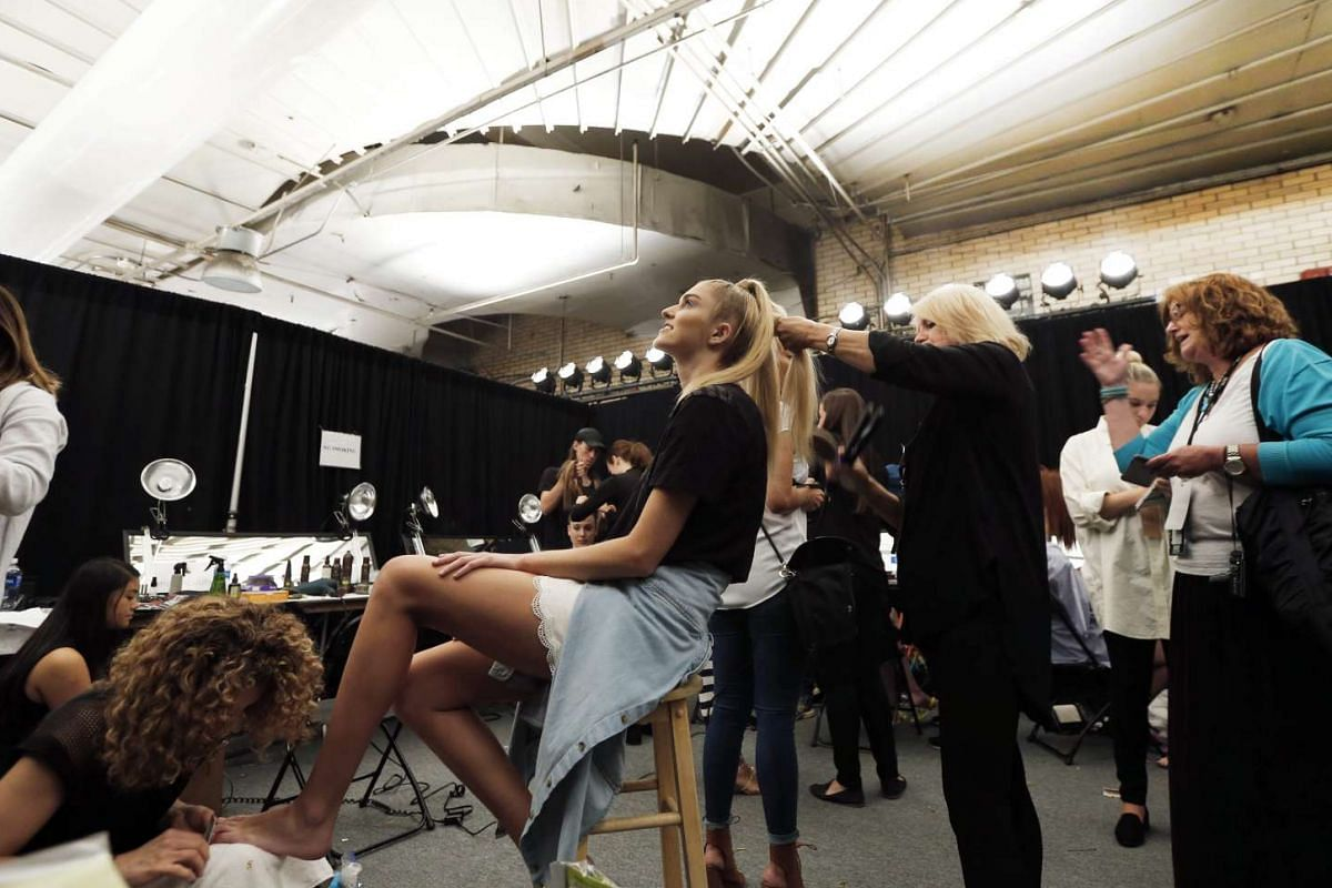 A model has her hair done backstage before the Nicholas K fashion show New York Fashion Week in New York, US on Sept 8, 2016.