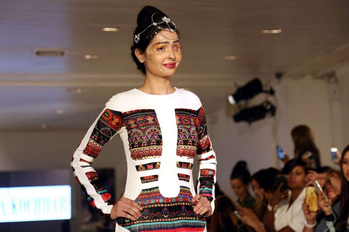 Acid attack survivor Reshma Bano of India walks the runway during the FTL Moda presentation at New York Fashion Week on Sept 8, 2016.